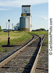 Grain Elevator Near Tracks - A grain elevator situated near...