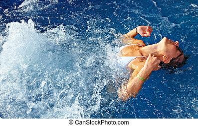 Woman in jacuzzi - Beautiful girl relaxing in jacuzzi. Spa...