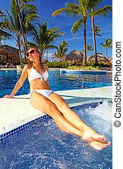 Beautiful girl relaxing near pool - Beautiful girl relaxing...