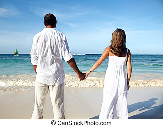 Romantic couple walking on beach