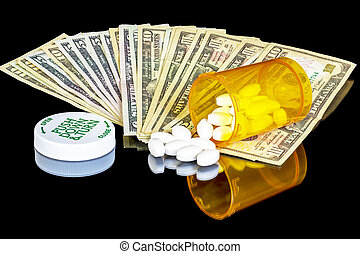 Pill bottle and cold hard cash - Several money bills with...