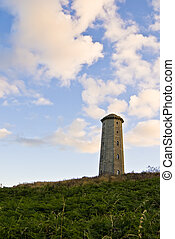 Old lighthouse in Wicklow, Ireland. A summer evening.