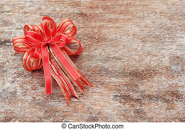 Red Ribbon on Old Wood Background