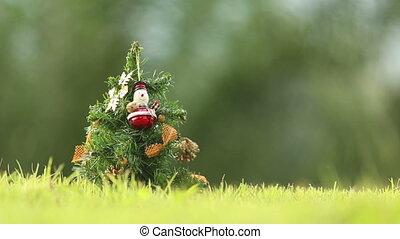 girl hangs the bell on the Christmas tree - girl hangs the...