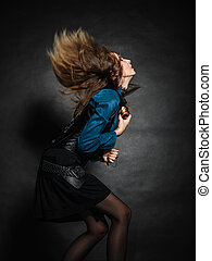 Action shot of an attractive woman swinging her hair - music...