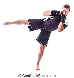 Kick boxer - a young kickboxer or boxer isolated over a...