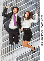 Jumping over Office building - An handsome businessman and a...