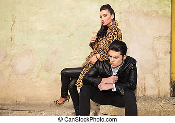 Young fashion woman sitting behind her lover
