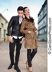 fashion woman leaning on her lover - Fashion man holding his...
