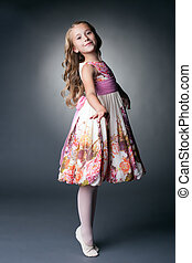 Smiling little dancer posing in studio - Image of smiling...