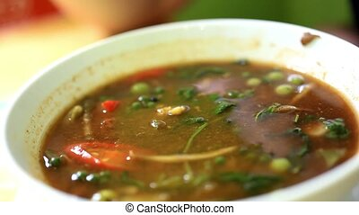 Eating sour soup with shrimp and spicy Thai style 1920x1080...