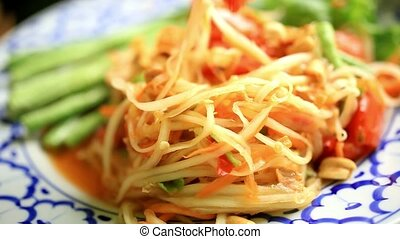 Eating som tam, Papaya salad, Thai cuisine Macro - Eating...