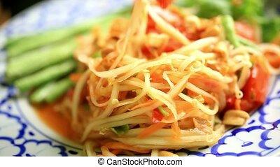 Eating som tam, Papaya salad, Thai cuisine. Macro - Eating...