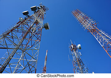 Telecommunication tower with a sunlight. Used to transmit...