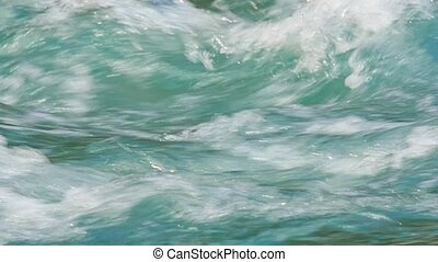 Turquoise water in mountain river - Flow of clear turquoise...
