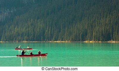 Lake Louise canoe - Floating on the lake Louise canoes,...