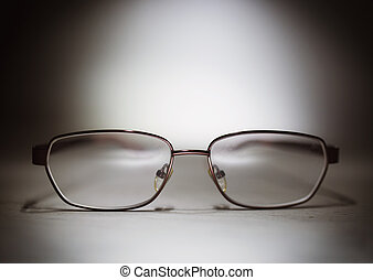 Eyeglasses on a wooden table
