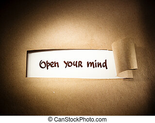 Open Your Mind appearing behind torn brown paper