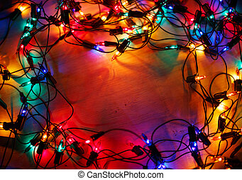 Christmas lights frame on wood background with copy space.Decora