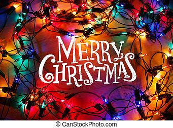 Christmas lights frame on wood background with Merry Christmas l