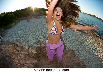 Crazy pretty woman enjoying the beach at sunset time