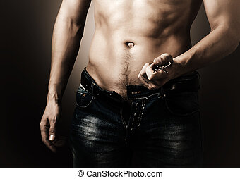 Man showing his muscular body. Stripper unzips jeans and...