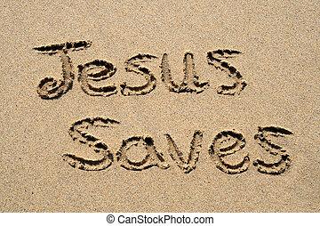 Jesus saves, written on a sandy beach