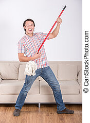 Cleaning - Funny man is mopping floor and playing music...