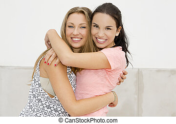 Happy firends - Portrait of a beautiful two young girls...