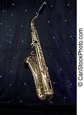 Saxophone and stars - Isolated saxophone over black...