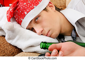 Drunken Teenager in Santa Hat - Sad and Tired Teenager with...
