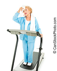 Senior Workout - Hot and Tired - Senior lady on a treadmill...