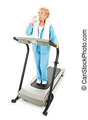 Senior Fitness - Hydration - Fit senior woman working out on...