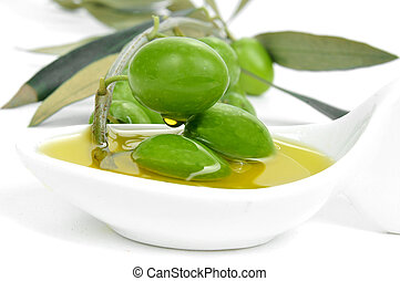 olives and olive oil - closeup of a twig of olive tree with...