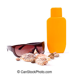 sunglasses and lotion closeup on white background