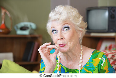 Lady Smoking Pot - Excited Caucasian senior woman in green...
