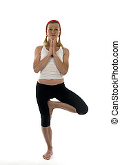 yoga  tree pose position vikram pose illustrated by attractive middle age fitness trainer teacher woman exercising and stretching