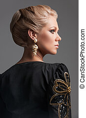 back view of beautiful blonde woman looking away. delicate...