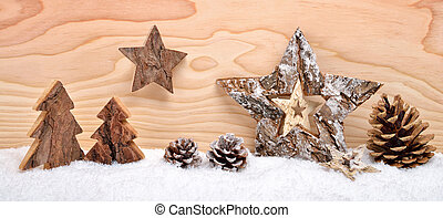 Christmas arrangement with wooden decoration
