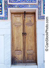 Samarkand - Finely carved wooden door at the Ulugh Beg...