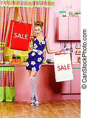 sale victory - Fashionable pin-up girl standing with...