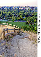 Foothills path and Boise Idaho - Dirt trail and city of...