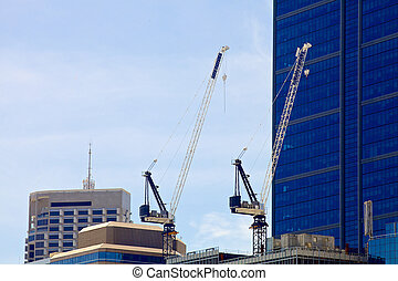 Crain on a new constraction site of high-rise building - A...
