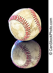 Old and used baseball with red laces - Boys baseball dirty...