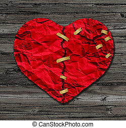Heart Therapy - Heart therapy as a red crumpled paper shaped...