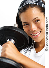 Fitness woman lifting weights