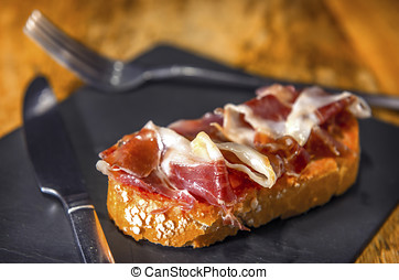 Spanish pintxo or pincho, montadito and tapas, from Basque...