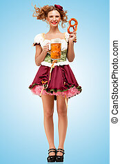Beer with snacks - Young sexy Oktoberfest waitress, wearing...