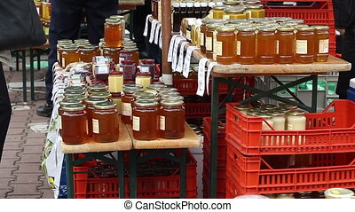 Honey Market - Bowls and jars of honey are placed in stacks...