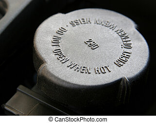 Radiator cap - Warning in a radiator cap, do not open